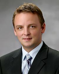 Travis A. Holt